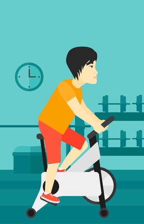 cardiovascular exercising: An asian man exercising on stationary training bicycle in the gym vector flat design illustration. Vertical layout.