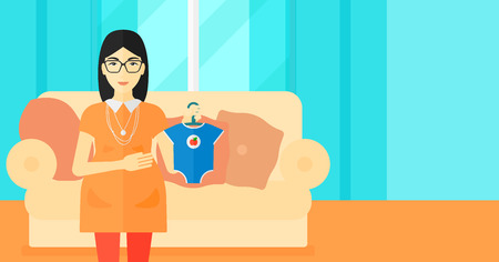 expectant: An asian pregnant woman holding clothes for her baby on the background of living room vector flat design illustration. Horizontal layout. Illustration