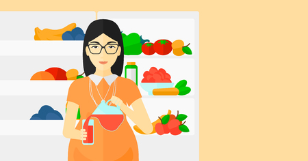 An asian pregnant woman pouring juice in a glass on the background of  refrigerator full of fruits and vegetables vector flat design illustration. Horizontal layout.