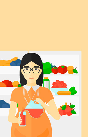 An asian pregnant woman pouring juice in a glass on the background of  refrigerator full of fruits and vegetables vector flat design illustration. Vertical layout.