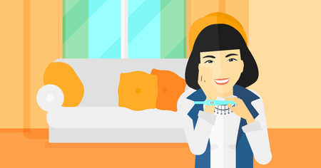 delighted: An asian delighted woman looking at positive pregnancy test on the background of living room vector flat design illustration. Horizontal layout.