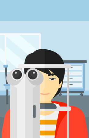 An asian man during eye exam on the background of medical office vector flat design illustration. Vertical layout.