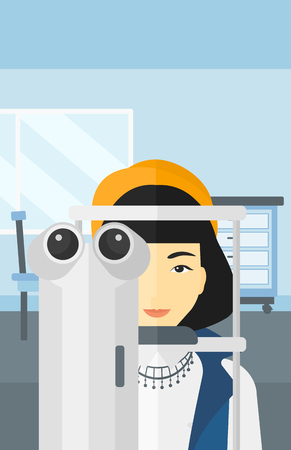 An asian woman during eye examon the background of medical office vector flat design illustration. Vertical layout.