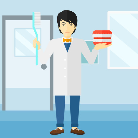 An asian man with a dental jaw model and a toothbrush on a polyclinic background vector flat design illustration. Square layout.