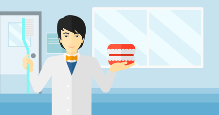 An asian man with a dental jaw model and a toothbrush on a polyclinic background vector flat design illustration. Horizontal layout.