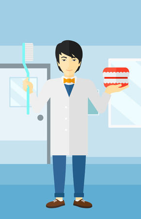 An asian man with a dental jaw model and a toothbrush on a polyclinic background vector flat design illustration. Vertical layout.
