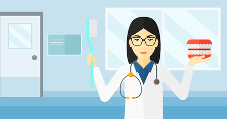 An asian woman with a dental jaw model and a toothbrush on a polyclinic background vector flat design illustration. Horizontal layout.