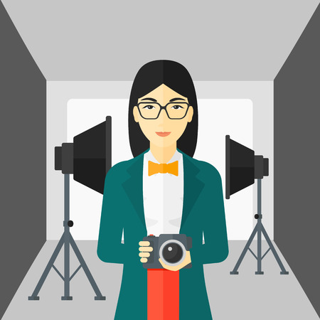 lighting equipment: An asian woman holding a camera on the background of photo studio with lighting equipment vector flat design illustration. Square layout. Illustration