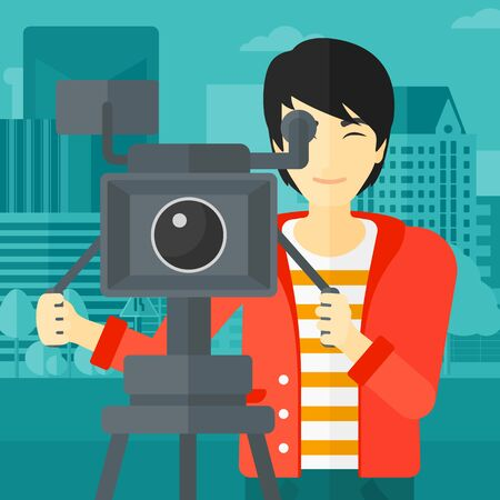cinematographer: An asian cameraman with the beard looking through movie camera on a city background vector flat design illustration. Square layout.