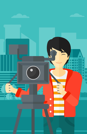 cinematographer: An asian cameraman with the beard looking through movie camera on a city background vector flat design illustration. Vertical layout. Illustration