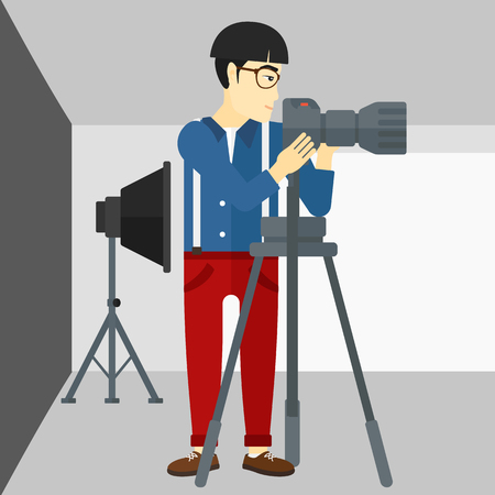 lighting equipment: An asian photographer working with camera on the background of photo studio with lighting equipment vector flat design illustration. Square layout.