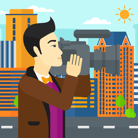 cinematograph: An asian cameraman with video camera taking a video on a city background vector flat design illustration. Square layout. Illustration