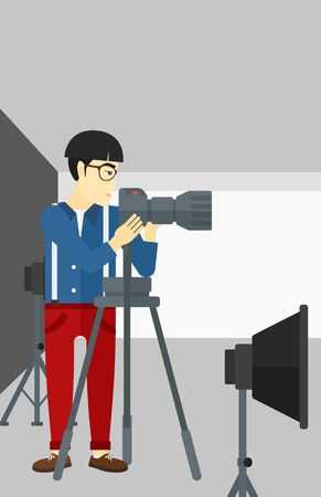 lighting equipment: An asian photographer working with camera on the background of photo studio with lighting equipment vector flat design illustration. Vertical layout.
