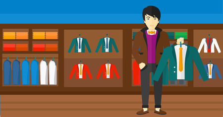 choosing clothes: An asian man holding a hanger with a jacket on the background of clothes store vector flat design illustration. Horizontal layout.