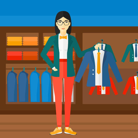 choosing clothes: An asian woman holding a hanger with a jacket on the background of clothes store vector flat design illustration. Square layout.