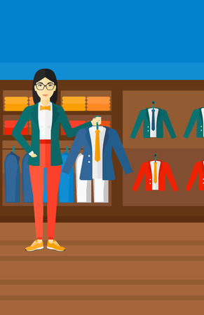 choosing clothes: An asian woman holding a hanger with a jacket on the background of clothes store vector flat design illustration. Vertical layout.