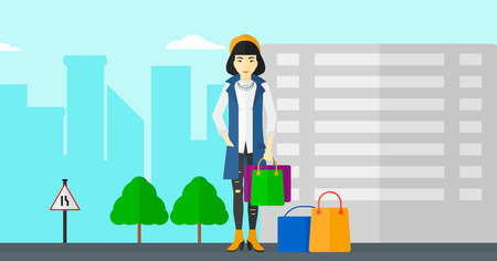 An asian woman standing with some shopping bags in hand and some bags on the ground on a city background vector flat design illustration. Horizontal layout.