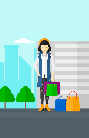 AAn asian  woman standing with some shopping bags in hand and some bags on the ground on a city background vector flat design illustration. Vertical layout. Illustration