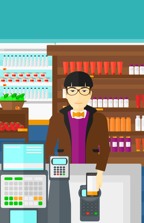 wireless terminals: An asian man paying with his smartphone using terminal on the background of supermarket shelves with products vector flat design illustration. Vertical layout. Illustration
