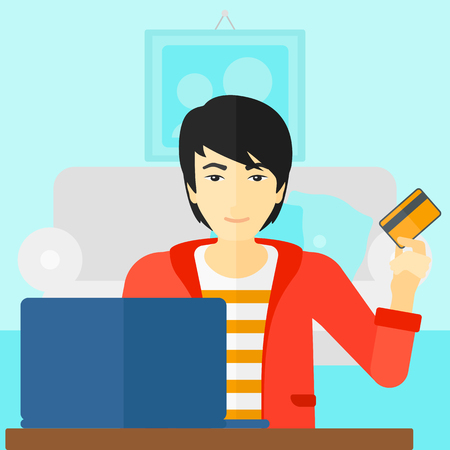 purchases: An asian man sitting in front of laptop with credit card in hand and making purchases online on the background of living room vector flat design illustration. Square layout.
