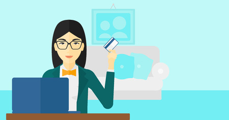 woman credit card: An asian woman sitting in front of laptop with credit card in hand and making purchases online on the background of living room vector flat design illustration. Horizontal layout.