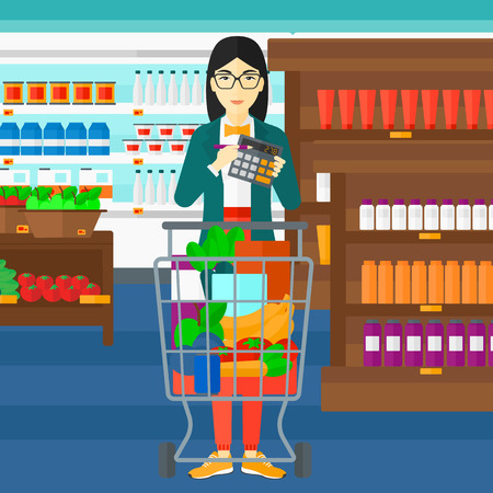An asian woman standing near shopping cart and holding a calculator in hands on the background of supermarket shelves with products vector flat design illustration. Square layout.