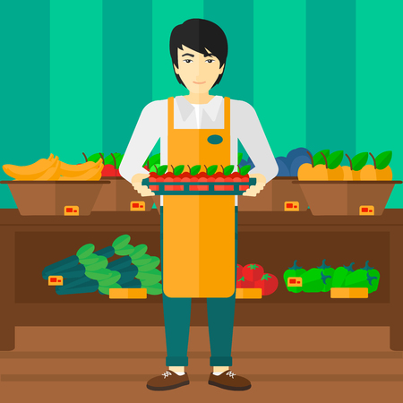 An asian man holding a box with apples on the background of shelves with vegetables and fruits in supermarket vector flat design illustration. Square layout.