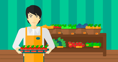 An asian man holding a box with apples on the background of shelves with vegetables and fruits in supermarket vector flat design illustration. Horizontal layout. Vettoriali