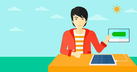 sun energy: An asian man charging a tablet computer with solar panel on the background of blue sky vector flat design illustration. Horizontal layout.