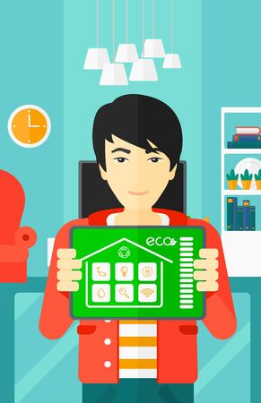 modern living room: An asian man holding a tablet computer with smart home application on a screen on the background of modern  living room vector flat design illustration. Vertical layout.