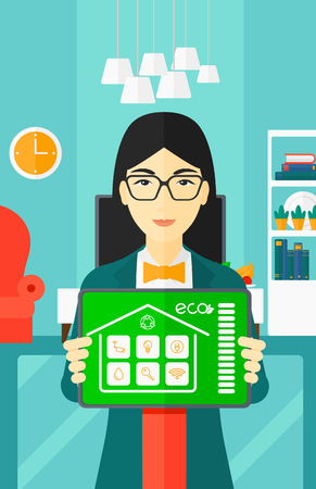 An asian woman holding a tablet computer with smart home application on a screen on the background of modern  living room vector flat design illustration. Vertical layout.
