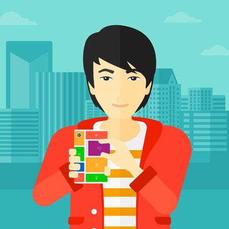 An asian man holding modular phone on a city background vector flat design illustration. Square layout. Illusztráció