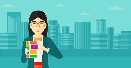 modular: An asian woman holding modular phone on a city background vector flat design illustration. Horizontal layout.
