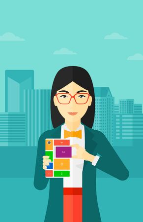 repurpose: An asian woman holding modular phone on a city background vector flat design illustration. Vertical layout. Illustration