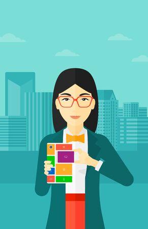 An asian woman holding modular phone on a city background vector flat design illustration. Vertical layout. Illusztráció