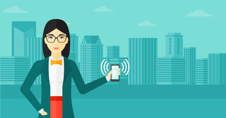 vibrate: An asian woman holding vibrating smartphone on a city background vector flat design illustration. Horizontal layout.