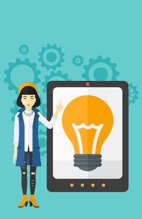computer screen: An asian woman pointing at a big tablet computer with a light bulb on a screen on a blue background with cogwheels vector flat design illustration. Vertical layout.