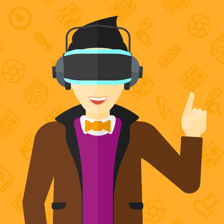 An asian man wearing a virtual relaity headset and pointing a forefinger up on a yellow background with media icons vector flat design illustration. Square layout.