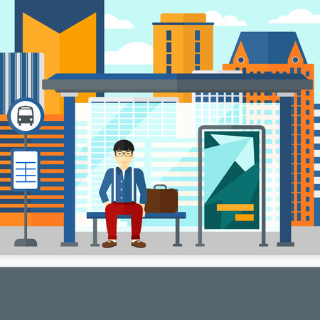 An asian man waiting for a bus at a bus-stop on a city background vector flat design illustration. Square layout.