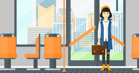 handgrip: An asian woman with a suitcase standing inside public transport vector flat design illustration. Horizontal layout.