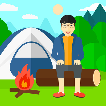 camping site: An asian man sitting on a log near the fire on the background of camping site with tent vector flat design illustration. Square layout.