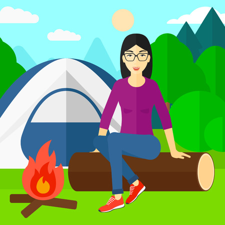 camping site: An asian woman sitting on a log near the fire on the background of camping site with tent vector flat design illustration. Square layout.