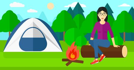 site: An asian woman sitting on a log near the fire on the background of camping site with tent vector flat design illustration. Horizontal layout. Illustration