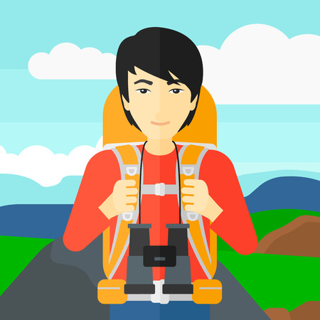 An asian man with backpack and binoculars hiking on the background of hilly countryside vector flat design illustration. Square layout. Imagens - 54902373