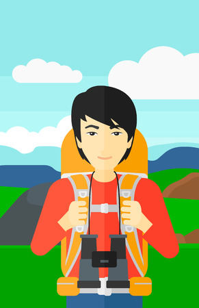 An asian man with backpack and binoculars hiking on the background of hilly countryside vector flat design illustration. Vertical layout. Ilustração