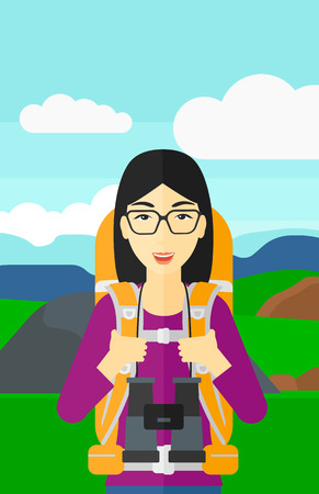 An asian woman with backpack and binoculars hiking on the background of hilly countryside vector flat design illustration. Vertical layout.