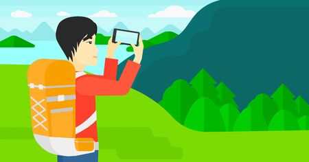 taking photo: An asian man taking photo of landscape with mountains and lake vector flat design illustration. Horizontal layout. Illustration