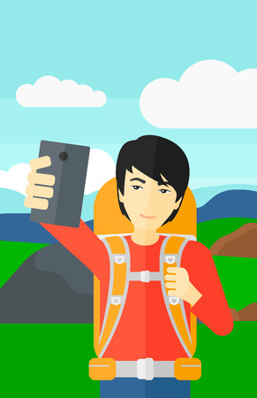 An asian man making selfie on the background of hilly countryside vector flat design illustration. Vertical layout.