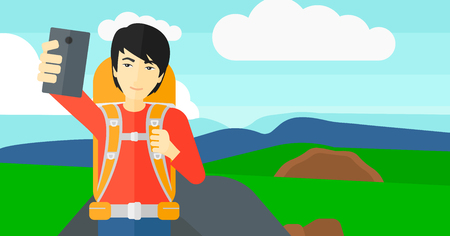 An asian man making selfie on the background of hilly countryside vector flat design illustration. Horizontal layout.