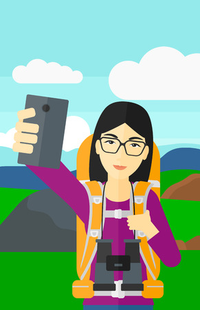 hilly: An asian woman making selfie on the background of hilly countryside vector flat design illustration. Vertical layout.